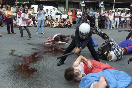 An anti-globalization group of protestors make a performance in front of the Italian embassy in central Barcelona, July 24, 2001. The group protested the death of Carlo Giuliani and the actions of the Italian police during the G-8 summit in Genoa last weekend.